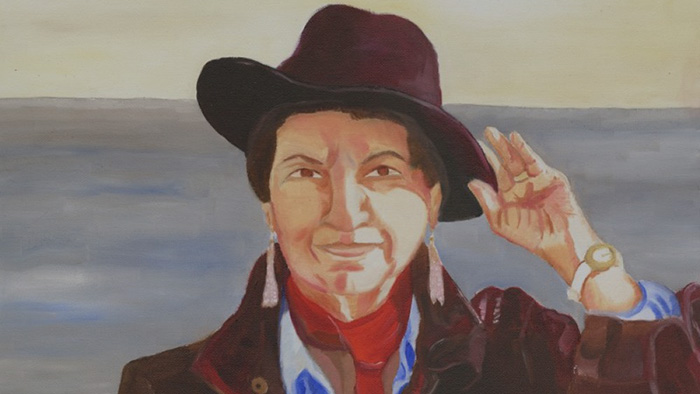 Painting representing Gloria E. Anzaldua wearing a large brown hat, whose values inspire the MA in Women, Gender, Spirituality, and Social Justice at California Institutes of Integral Studies